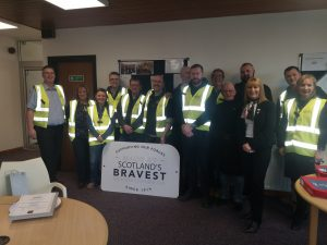 Royal British Legion Industries- a group picture of people in high viz vests